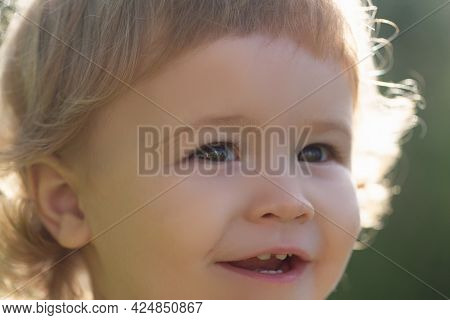 Close-up Portrait Of Cheerful Child. Cute Joyful Little Boy Kid, Cropped Macro Face. Kids Smiling, C
