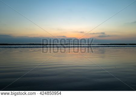 Calm Sea Ocean And Sky Background. Sea Water Landscape With Clouds On Horizon. Natural Tropical Wate