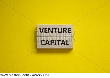 Venture Capital Symbol. Wooden Blocks With Words Venture Capital On Beautiful Yellow Background, Cop