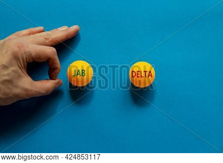 Covid-19 Delta Variant Strain Symbol. Male Hand Is About To Flick The Ball. Orange Table Tennis Ball