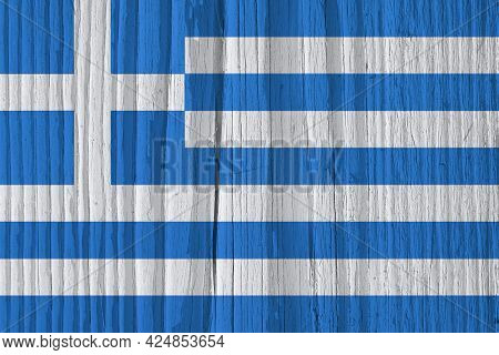 The Flag Of Greece On Dry Wooden Surface, Cracked With Age. It Seems To Flutter In The Wind. Backgro