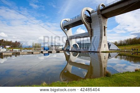 FALKIRK, UNITED KINGDOM - APRIL 11: Falkirk Wheel with blue sky on April 11, 2012 in Falkirk Scotland. The Wheel is a rotating boat lift connecting the Forth and Clyde Canal with the Union Canal.
