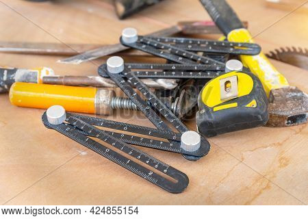Different Tools On The Wooden Table Background,  Different Construction Tools With Hand Tools For Ho