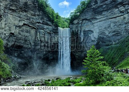 TRUMANSBURG, NEW YORK - 20 JUNE 2021: Taughannock Falls near Ithaca, New York and Cayuga Lake, plunge 215 feet which is 33 feet taller than Niagara Falls.