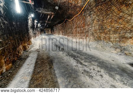Underground Mine. Underground Road For Transport. The Walls And Ceiling Of The Tunnel Are Reinforced