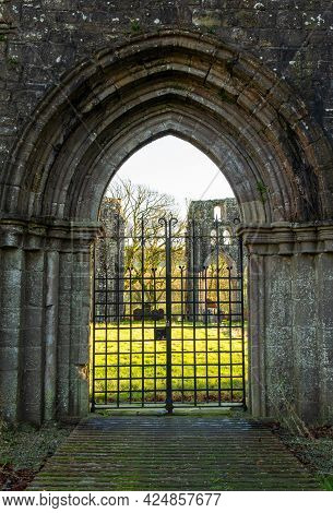 Gated Archway Entrance At Dundrennan Abbey, A Medieval Abbey In Dumfries And Galloway, Scotland