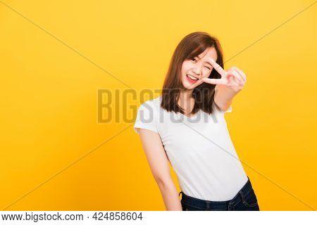 Asian Happy Portrait Beautiful Cute Young Woman Teen Smile Standing Wear T-shirt Showing Finger Maki