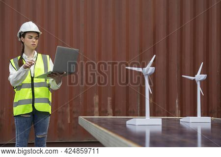 Young Caucasian Woman University Student Learning And Experimental Wind And Sunlight Renewable Energ