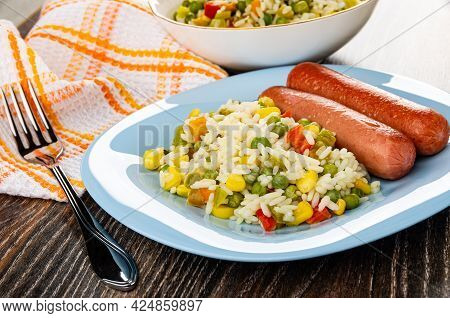 White Bowl With Vegetable Mix, Checkered Napkin, Fork, Fried Sausages With Hawaiian Blend In Light-b