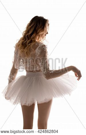 Anonymous Female Ballet Dancer Touching Tutu Skirt