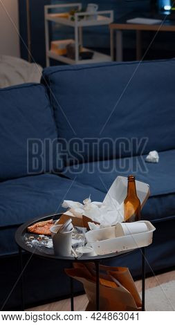 Leftover Of Pizza Empty Beer Bottles And Napkins On Table In Messy Living Room With Nobody In, Food