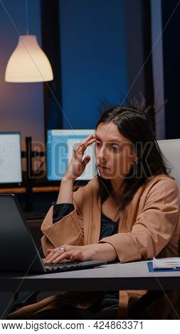 Overworked Exhausted Businesswoman Working In Startup Office Checking Management Strategy On Laptop