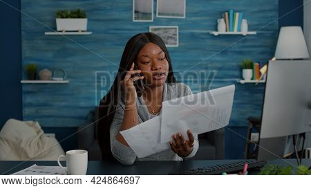 Upset Student Sitting At Desk Table In Living Room Explaining High School Homework Discussing With C