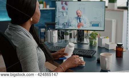 Sick Woman Patient Discussing Pills Treatment For Respiratory Sickness With Therapist During Healthc