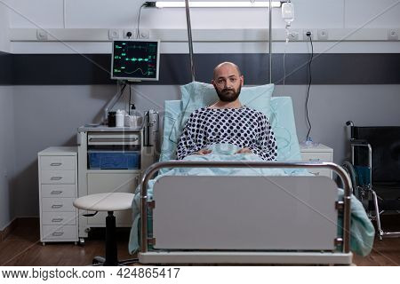 Potrait Of Depressed Sick Man Lying In Bed Waiting For Respiratory Treatment Recovering After Medica