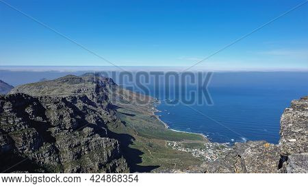 View From The Top Of Table Mountain In Cape Town. Curvy Atlantic Coastline, Town Houses. On The Gray