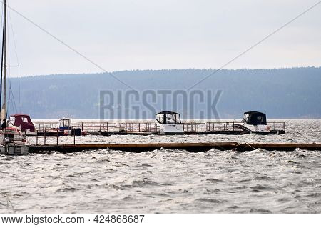 A Pier On The River With Several Motor Boats. Selective Focus.