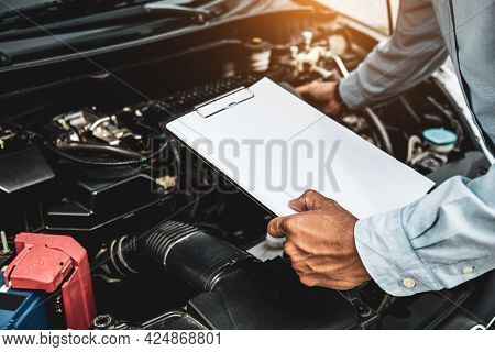 Car Care Maintenance And Servicing, Hand Mechanic Using The Checklist After Change Spare Part Car En