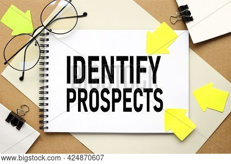 Identify Prospects. Inscription On A Notebook On A Craft And Gray Background