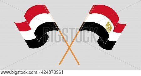 Crossed And Waving Flags Of Egypt And Yemen