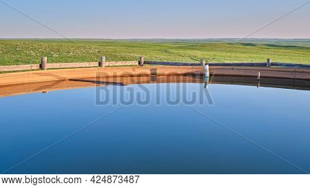 cattle water tank in a green prairie - Pawnee National Grassland in northern Colorado, late spring scanery