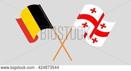 Crossed And Waving Flags Of Georgia And Belgium