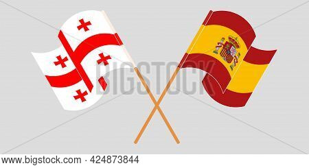 Crossed And Waving Flags Of Georgia And Spain