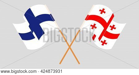 Crossed And Waving Flags Of Georgia And Finland