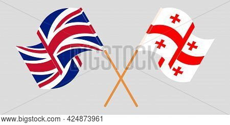 Crossed And Waving Flags Of Georgia And The Uk