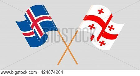 Crossed And Waving Flags Of Georgia And Iceland