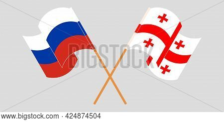 Crossed And Waving Flags Of Georgia And Russia
