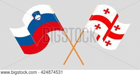 Crossed And Waving Flags Of Georgia And Slovenia