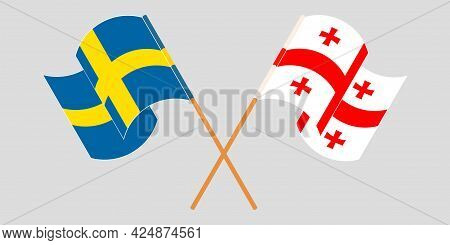 Crossed And Waving Flags Of Georgia And Sweden