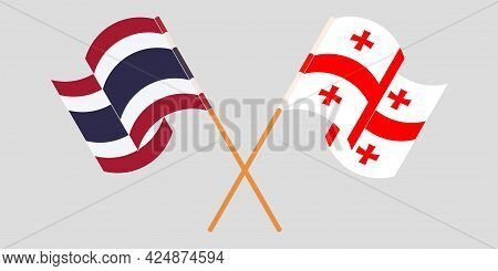 Crossed And Waving Flags Of Georgia And Thailand
