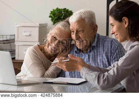 Female Agent Consult Old Couple Buyers In Office