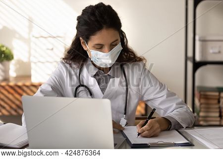 Female Doctor In Facemask Work In Hospital