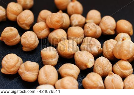 Several Chickpeas Pieces On Black Background Close-up