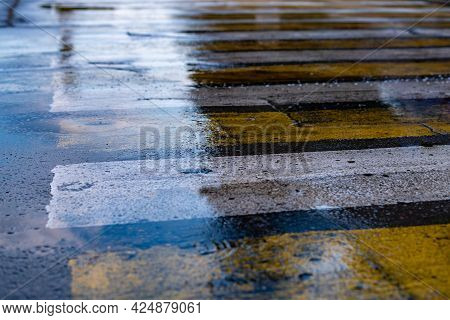Close Up Wet Roadway Traffic Territory With Puddles After Rain