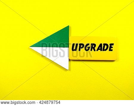 Colorful Wooden Board With Text Upgrade On Yellow Background.