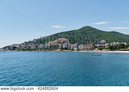 View From The Sea To The Buildings And The Beach Of Budva. Montenegro