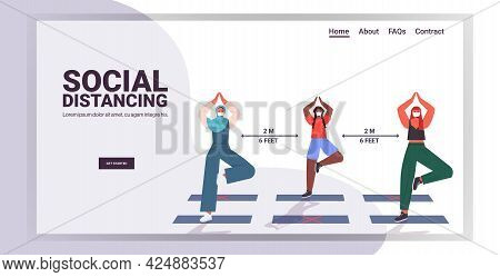 Mix Race Girls In Masks Doing Yoga Exercises Keeping Distance To Prevent Coronavirus Social Distanci