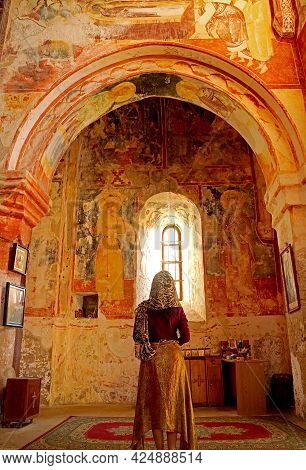 Female Visitor Being Impressed With The Medieval Frescoes Inside The Church Of Gerati Monastery, Kut
