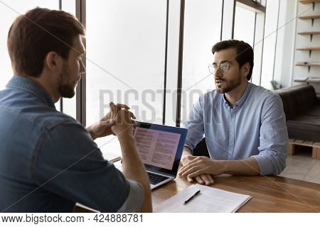 Skilled Young Male Hr Manager Holding Job Interview With Candidate.