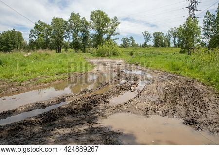The Harsh Landscape Nature And Road Through The Fields For The Off-road Suv With Puddles And Mud. Sp