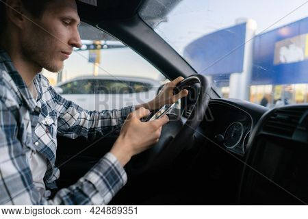The Male Driver In The Vehicle Using The Smartphone, Accident On The Road