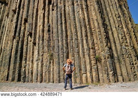 Traveler Looking Up To 50 Meters High Breathtaking Basalt Columns Known As The Symphony Of Stones At