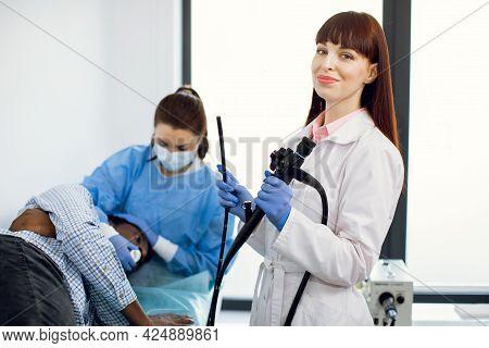 Endoscopy Concept. Portrait Of Young Caucasian Woman Doctor Holding Endoscope Before Endoscopy. Nurs