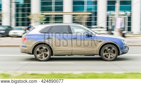 Moscow , Russia - May 2021: Dirty And Dusty Suv Car Bentley Bentayga At The City Street