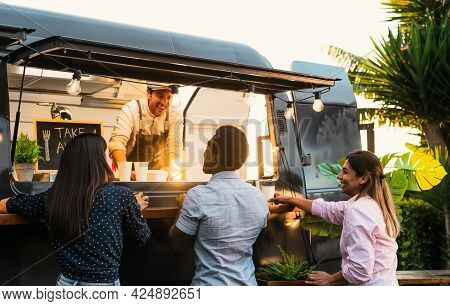 Young People Buying Meal From Street Food Truck - Modern Business And Take Away Concept