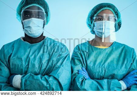 Multiracial Doctors Wearing Personal Protective Equipment Fighting Against Corona Virus Outbreak - H